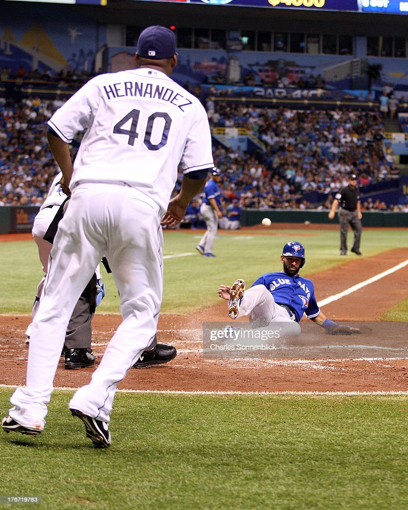 Jose Bautista #19 of the Toronto Blue Jays scores the second run of the third inning against the Tampa Bay Rays during the game on August 17, 2013 at Tropicana Field in St. Petersburg, Florida.