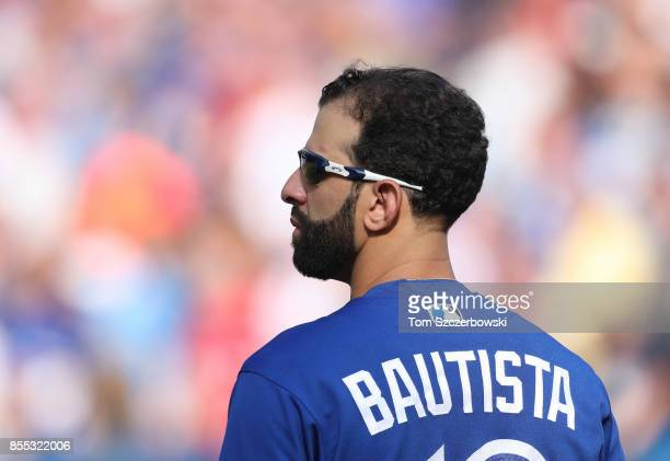 Jose Bautista of the Toronto Blue Jays stands during the playing of the national anthems before the start of MLB game action against the New York...
