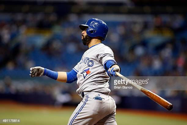 Jose Bautista of the Toronto Blue Jays strikes out swinging to pitcher Chris Archer of the Tampa Bay Rays to end the top of the first inning of a...