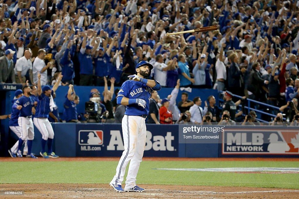 Jose Bautista #19 of the Toronto Blue Jays throws his bat up in the air after he hits a three-run home run in the seventh inning against the Texas Rangers in game five of the American League Division Series at Rogers Centre on October 14, 2015 in Toronto, Canada.