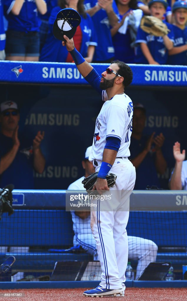 Jose Bautista #19 of the Toronto Blue Jays tips his hat to the fans after he is pulled from the game in the ninth inning during MLB game action against the New York Yankees at Rogers Centre on September 24, 2017 in Toronto, Canada.
