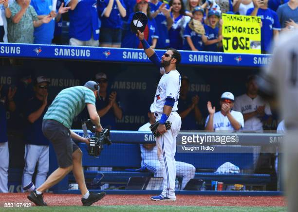 Jose Bautista of the Toronto Blue Jays tips his hat to the fans after he is pulled from the game in the ninth inning during MLB game action against...