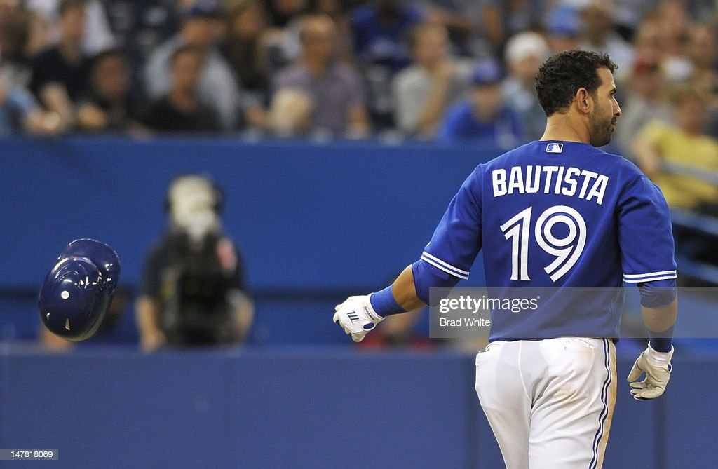 Jose Bautista #19 of the Toronto Blue Jays tosses his helmet after striking out during MLB game action against the Kansas City Royals July 3, 2012 at Rogers Centre in Toronto, Ontario, Canada.