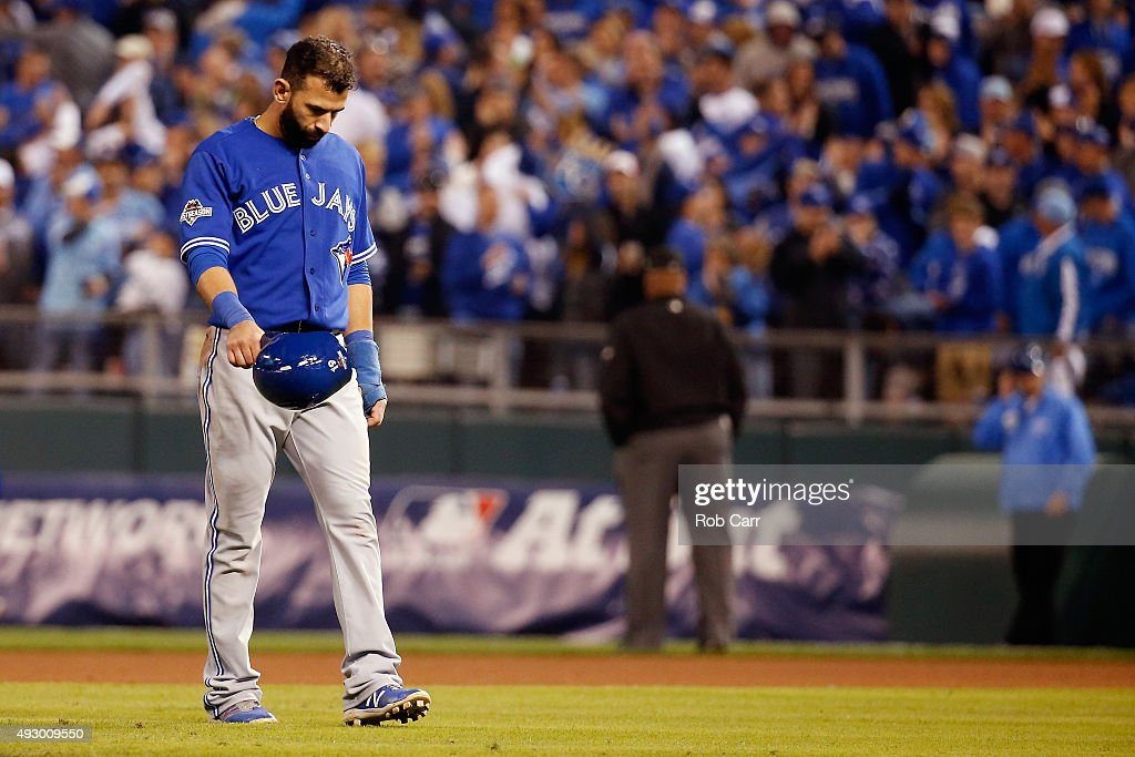 Jose Bautista #19 of the Toronto Blue Jays walks off the field after being forced out at second base in the eighth inning against the Kansas City Royals during game one of the American League Championship Series at Kauffman Stadium on October 16, 2015 in Kansas City, Missouri.