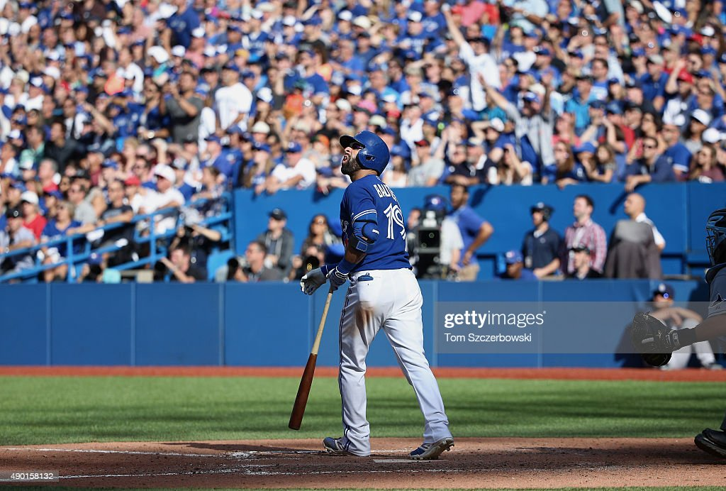Jose Bautista #19 of the Toronto Blue Jays watches his solo home run in the eighth inning during MLB game action against the Tampa Bay Rays on September 26, 2015 at Rogers Centre in Toronto, Ontario, Canada.