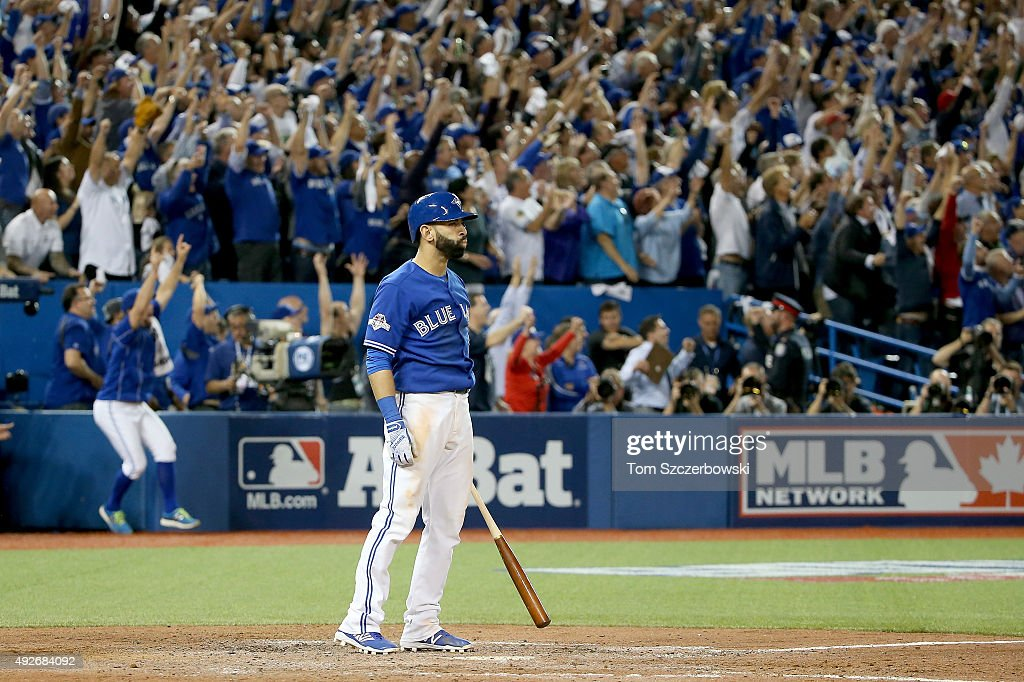 Jose Bautista of the Toronto Blue Jays watches his threerun home run in the seventh inning against the Texas Rangers in game five of the American...