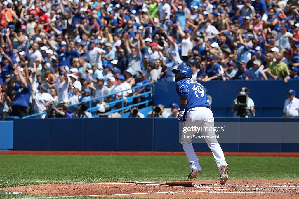 Jose Bautista #19 of the Toronto Blue Jays watches the ball as he hits a two-run home run in the third inning during MLB game action against the New York Yankees on August 16, 2015 at Rogers Centre in Toronto, Ontario, Canada.