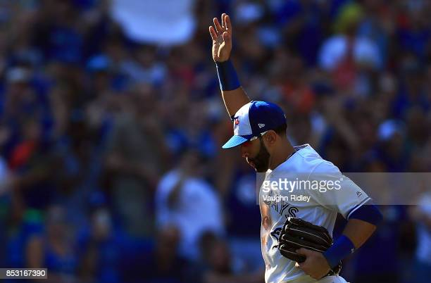 Jose Bautista of the Toronto Blue Jays waves to the fans after he is pulled from the game in the ninth inning during MLB game action against the New...