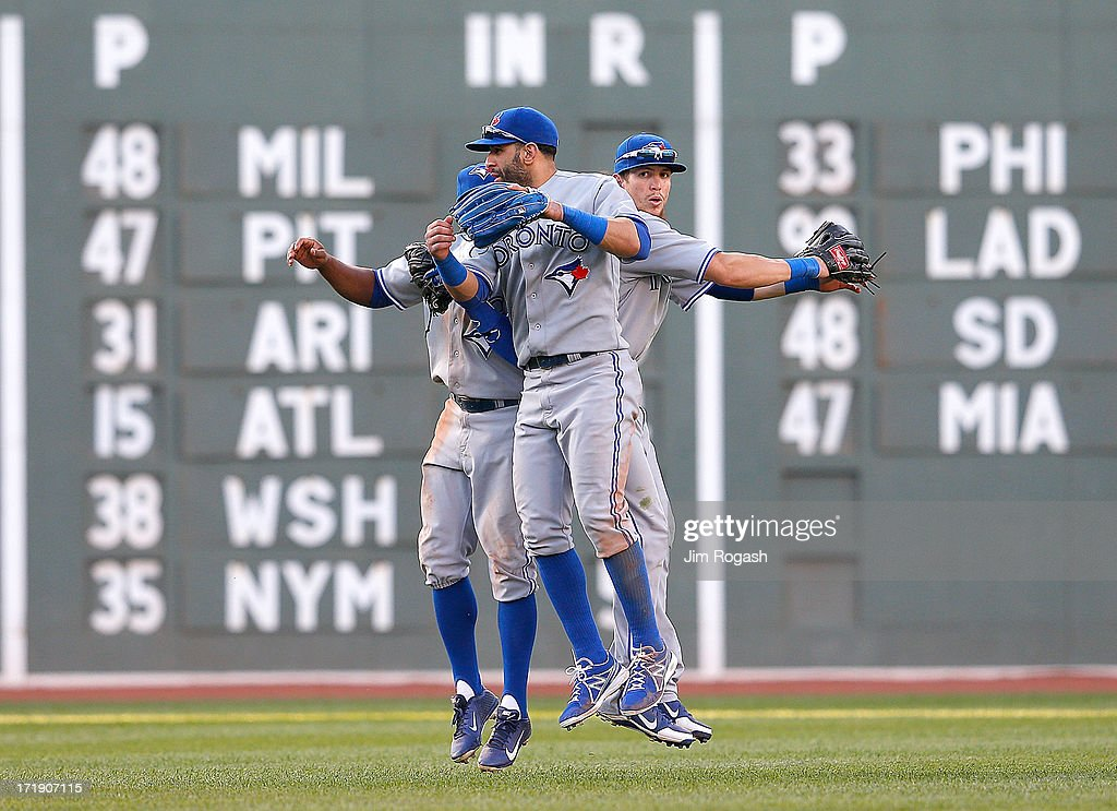 Jose Bautista #19, <a gi-track='captionPersonalityLinkClicked' href=/galleries/search?phrase=Rajai+Davis&family=editorial&specificpeople=810608 ng-click='$event.stopPropagation()'>Rajai Davis</a> #11, <a gi-track='captionPersonalityLinkClicked' href=/galleries/search?phrase=Colby+Rasmus&family=editorial&specificpeople=3988372 ng-click='$event.stopPropagation()'>Colby Rasmus</a> #28 of the Toronto Blue Jays celebrates their win against the Boston Red Sox at Fenway Park on June 29, 2013 in Boston, Massachusetts.