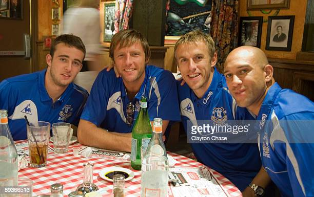 Jose Baxter Carlo Nash Philip Neville and Tim Howard pose for a picture as Buca di Beppo hosts pregame meal for Everton Football Club in Salt Lake...