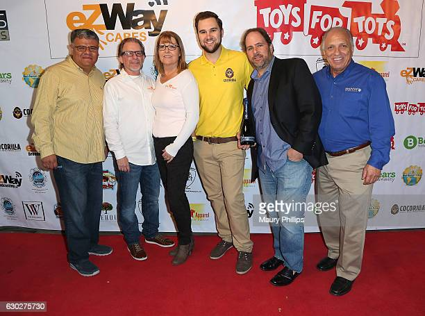 Jose Beltran Bill Conradi Kelle Conradi Peter Conway Michael Lewison and Bob Harris arrive at eZWayCares Community Santa Toy Drive on December 18...