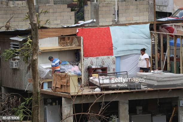 Jose Bernard and his daughter Yolymar Bernard salvage what they can from their home that was destroyed when Hurricane Maria passed through on...