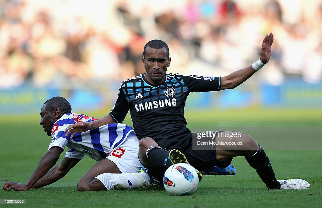 Jose Bosingwa of Chelsea fouls Shaun WrightPhillips of Queens Park Rangers and is sent off by referee Chris Foy during the Barclays Premier League...