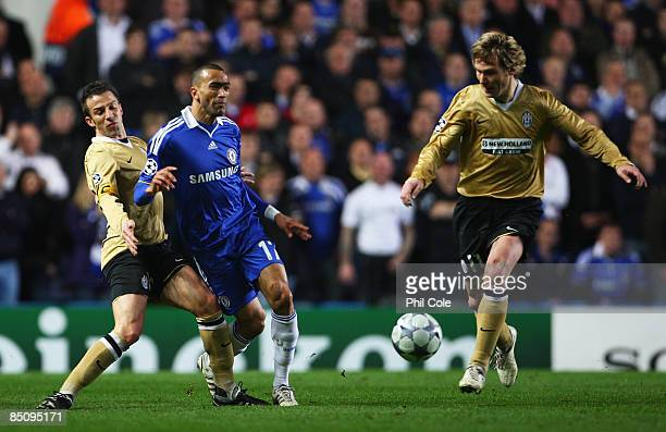 Jose Bosingwa of Chelsea is challenged by Alessandro Del Piero of Juventus as Pavel Nedved of Juventus looks on during the UEFA Champions League...
