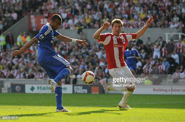 Jose Bosingwa of Chelsea shoots past Richard Cresswell of Stoke City to score their first goal during the Barclays Premier League match between Stoke...