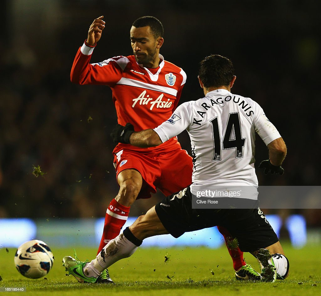 Jose Boswinga of Queens Park Rangers is tackled by Giorgos Karagounis of Fulham during the Barclays Premier League match between Fulham and Queens Park Rangers at Craven Cottage on April 1, 2013 in London, England.