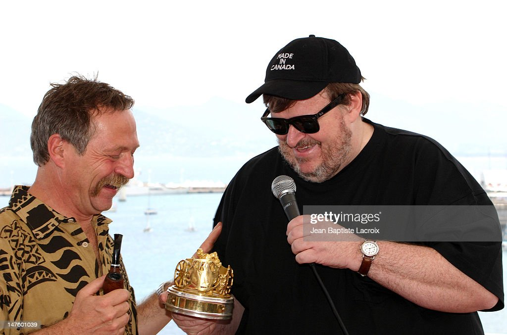 <a gi-track='captionPersonalityLinkClicked' href=/galleries/search?phrase=Jose+Bove&family=editorial&specificpeople=211205 ng-click='$event.stopPropagation()'>Jose Bove</a> and Michael Moore during 2004 Cannes Film Festival - Various Celebrities in Cannes, France.