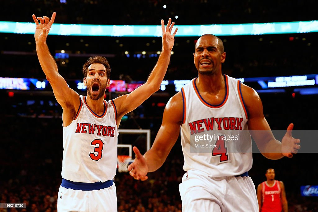 Jose Calderon #3 and <a gi-track='captionPersonalityLinkClicked' href=/galleries/search?phrase=Arron+Afflalo&family=editorial&specificpeople=640861 ng-click='$event.stopPropagation()'>Arron Afflalo</a> #4 of the New York Knicks reacts during the game against the Houston Rockets at Madison Square Garden on November 29, 2015 in New York City.