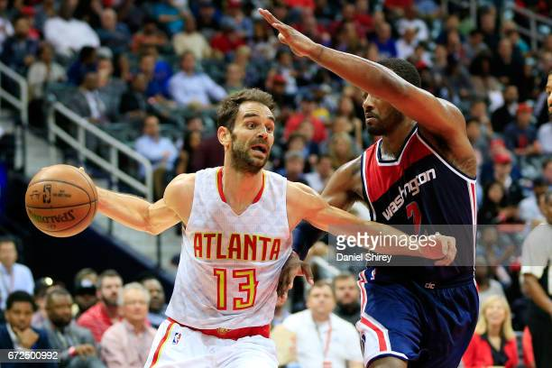Jose Calderon of the Atlanta Hawks drives to the basket past John Wall of the Washington Wizards along the baseline during the second quarter against...