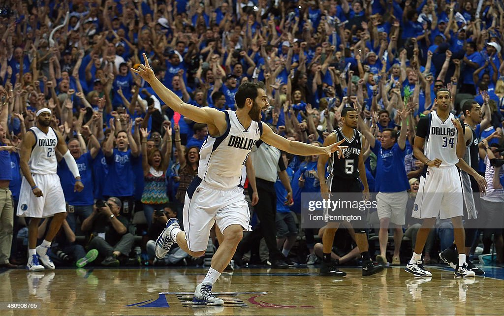 <a gi-track='captionPersonalityLinkClicked' href=/galleries/search?phrase=Jose+Calderon&family=editorial&specificpeople=548297 ng-click='$event.stopPropagation()'>Jose Calderon</a> #8 of the Dallas Mavericks celebrates after <a gi-track='captionPersonalityLinkClicked' href=/galleries/search?phrase=Vince+Carter&family=editorial&specificpeople=201488 ng-click='$event.stopPropagation()'>Vince Carter</a> #25 of the Dallas Mavericks made the game winning shot against the San Antonio Spurs during Game Three of the Western Conference Quarterfinals during the 2014 NBA Playoffs at American Airlines Center on April 26, 2014 in Dallas, Texas.