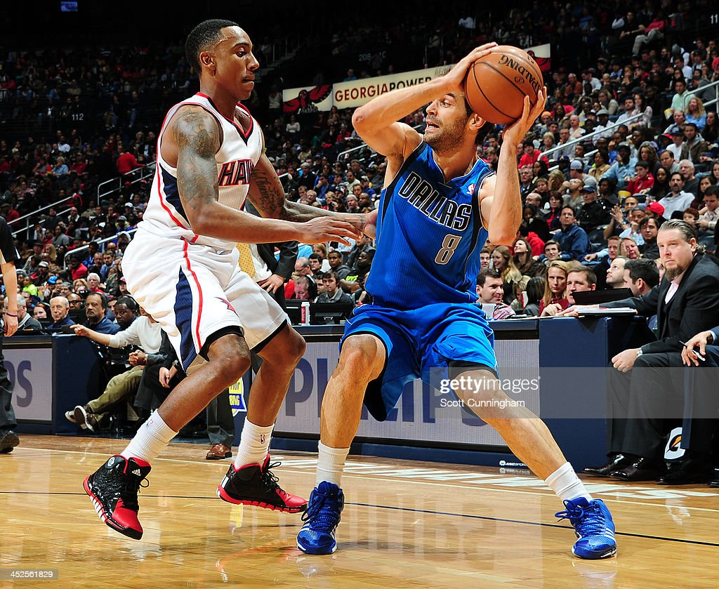 Jose Calderon #8 of the Dallas Mavericks looks to pass against <a gi-track='captionPersonalityLinkClicked' href=/galleries/search?phrase=Jeff+Teague&family=editorial&specificpeople=4680498 ng-click='$event.stopPropagation()'>Jeff Teague</a> #0 of the Atlanta Hawks on November 29, 2013 at Philips Arena in Atlanta, Georgia.