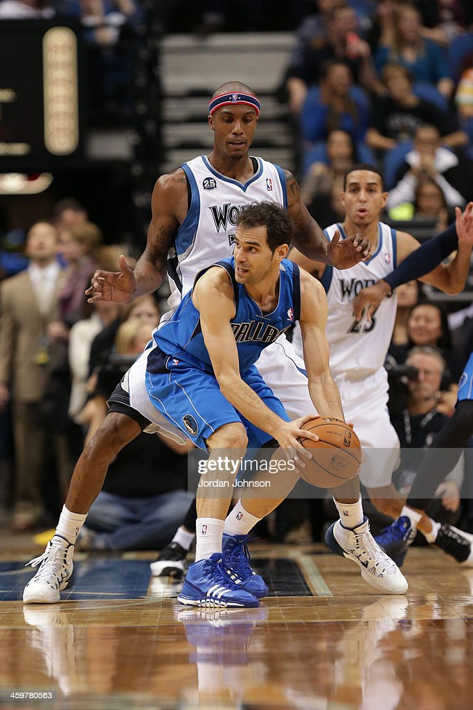 <a gi-track='captionPersonalityLinkClicked' href=/galleries/search?phrase=Jose+Calderon&family=editorial&specificpeople=548297 ng-click='$event.stopPropagation()'>Jose Calderon</a> #8 of the Dallas Mavericks looks to pass the ball against the Minnesota Timberwolves on November 8, 2013 at Target Center in Minneapolis, Minnesota.