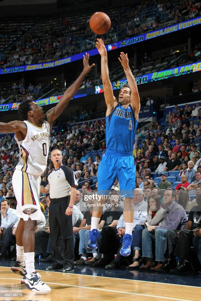 <a gi-track='captionPersonalityLinkClicked' href=/galleries/search?phrase=Jose+Calderon&family=editorial&specificpeople=548297 ng-click='$event.stopPropagation()'>Jose Calderon</a> #8 of the Dallas Mavericks shoots against <a gi-track='captionPersonalityLinkClicked' href=/galleries/search?phrase=Al-Farouq+Aminu&family=editorial&specificpeople=5042446 ng-click='$event.stopPropagation()'>Al-Farouq Aminu</a> #0 of the New Orleans Pelicans on December 4, 2013 at the New Orleans Arena in New Orleans, Louisiana.