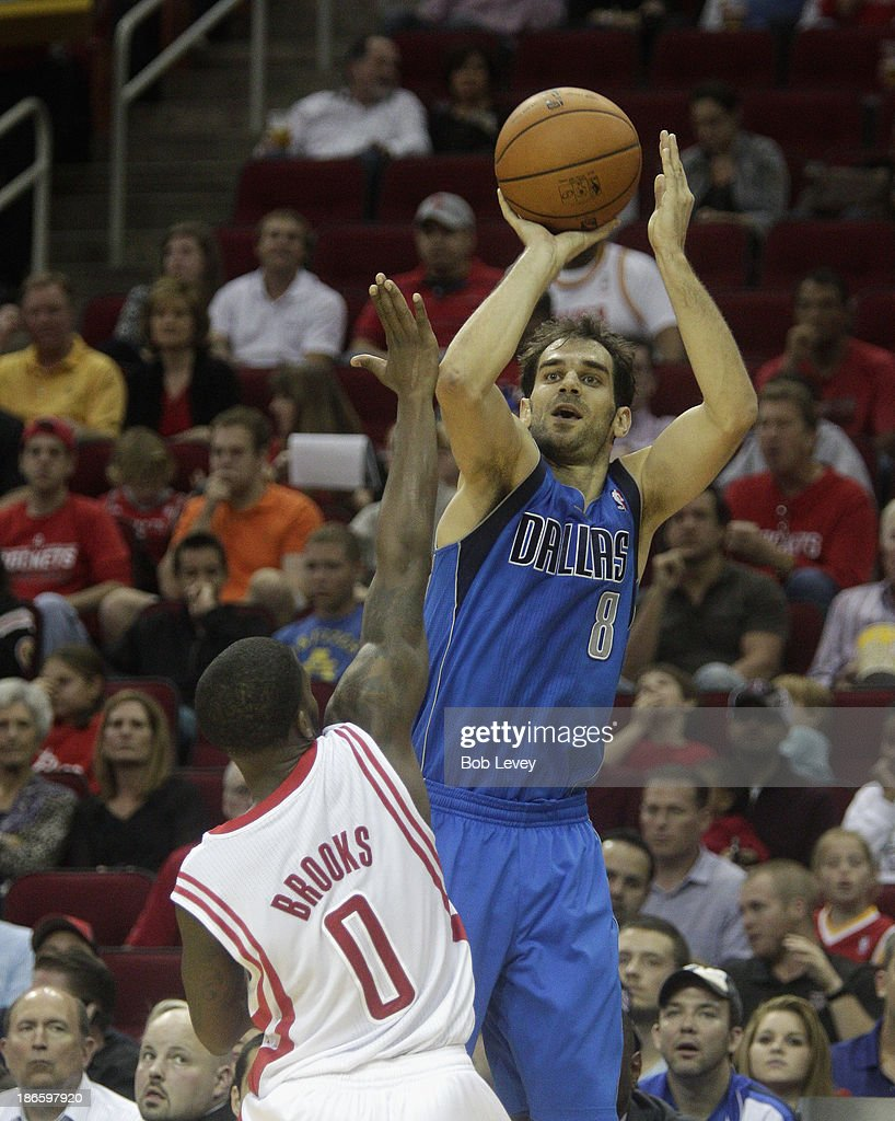 <a gi-track='captionPersonalityLinkClicked' href=/galleries/search?phrase=Jose+Calderon&family=editorial&specificpeople=548297 ng-click='$event.stopPropagation()'>Jose Calderon</a> #8 of the Dallas Mavericks shoots over Aaron Brooks #0 of the Houston Rockets at Toyota Center on November 1, 2013 in Houston, Texas.