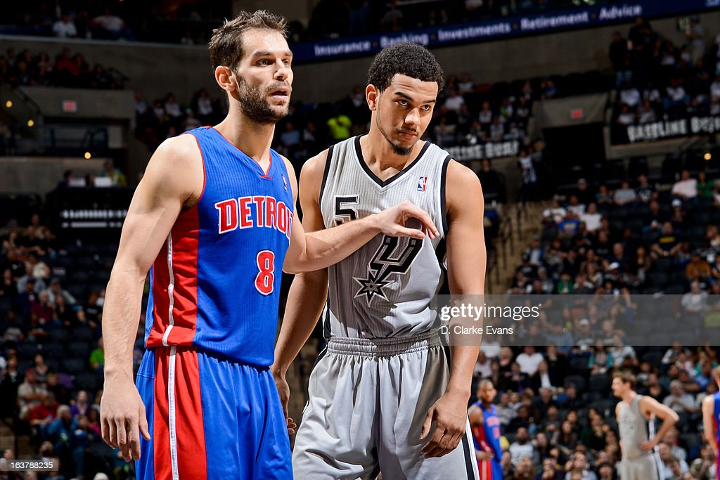 Jose Calderon #8 of the Detroit Pistons and Cory Joseph #5 of the San Antonio Spurs wait to resume play action during their game on March 3, 2013 at the AT&T Center in San Antonio, Texas.