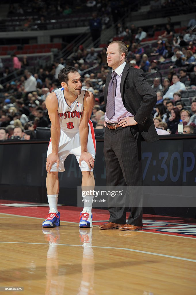 Jose Calderon #8 of the Detroit Pistons and Lawrence Frank the Head Coach have a conference on the sidelines against the Minnesota Timberwolves during the game on March 26, 2013 at The Palace of Auburn Hills in Auburn Hills, Michigan.