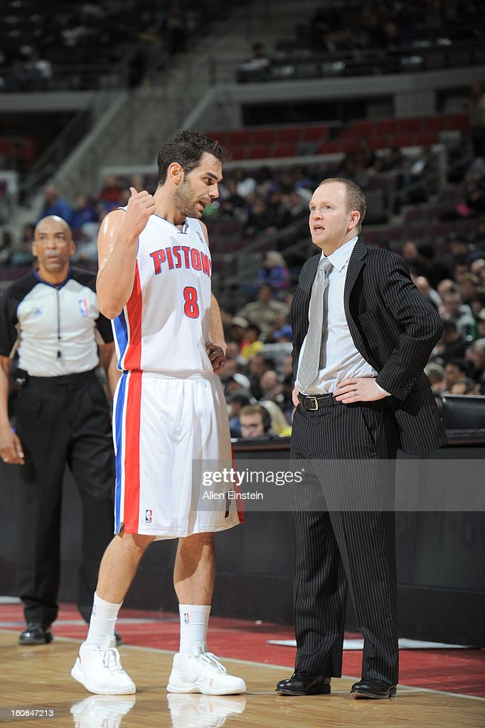Jose Calderon #8 of the Detroit Pistons and the Head Coach, Lawrence Frank, share a word during a break in play against the Brooklyn Nets on February 6, 2013 at The Palace of Auburn Hills in Auburn Hills, Michigan.
