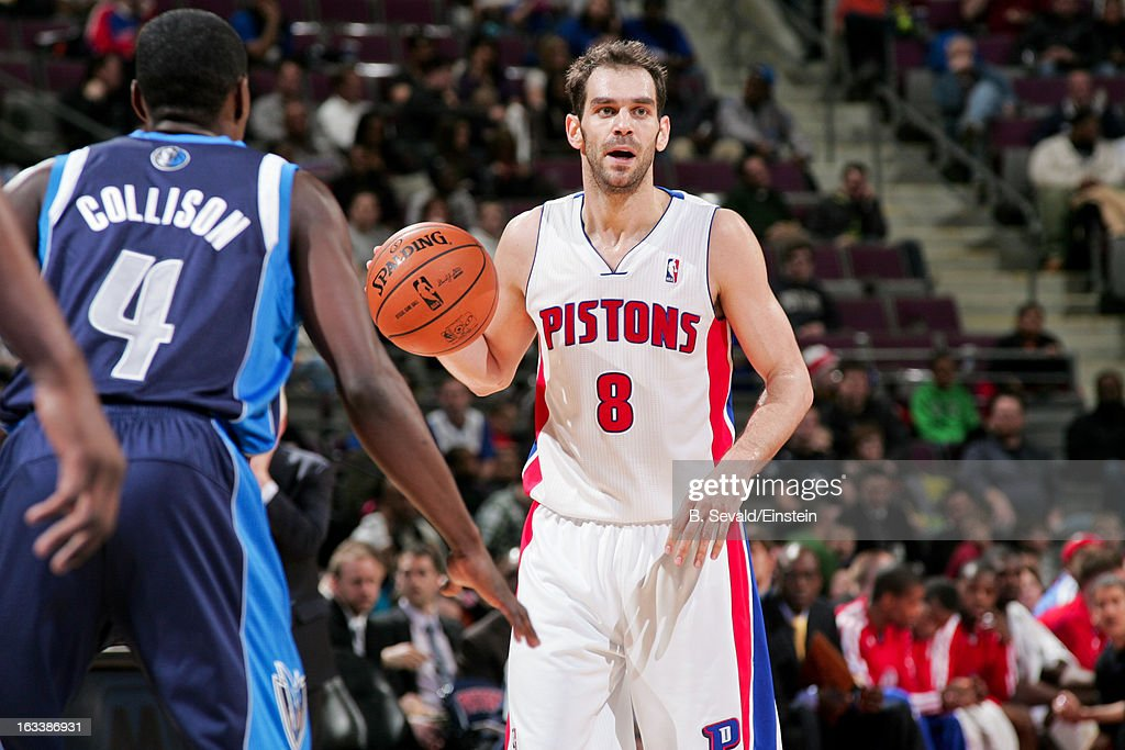 Jose Calderon #8 of the Detroit Pistons controls the ball against <a gi-track='captionPersonalityLinkClicked' href=/galleries/search?phrase=Darren+Collison&family=editorial&specificpeople=699031 ng-click='$event.stopPropagation()'>Darren Collison</a> #4 of the Dallas Mavericks on March 8, 2013 at The Palace of Auburn Hills in Auburn Hills, Michigan.