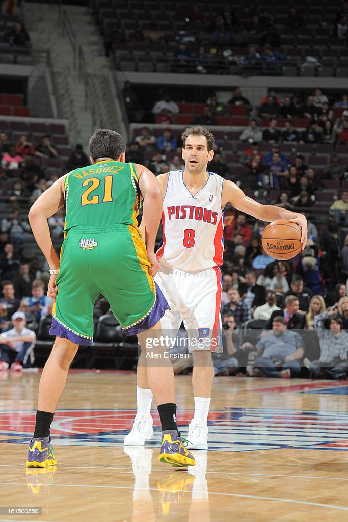Jose Calderon #8 of the Detroit Pistons controls the ball against Greivis Vasquez #21 of the New Orleans Hornets on February 11, 2013 at The Palace of Auburn Hills in Auburn Hills, Michigan.