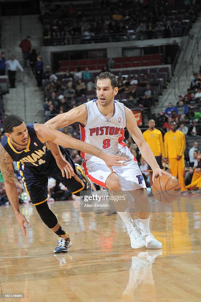 Jose Calderon #8 of the Detroit Pistons drives against <a gi-track='captionPersonalityLinkClicked' href=/galleries/search?phrase=D.J.+Augustin&family=editorial&specificpeople=3847521 ng-click='$event.stopPropagation()'>D.J. Augustin</a> #14 of the Indiana Pacers on February 23, 2013 at The Palace of Auburn Hills in Auburn Hills, Michigan.