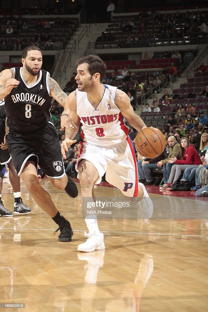 Jose Calderon #8 of the Detroit Pistons drives past <a gi-track='captionPersonalityLinkClicked' href=/galleries/search?phrase=Deron+Williams&family=editorial&specificpeople=203215 ng-click='$event.stopPropagation()'>Deron Williams</a> #8 of the Brooklyn Nets on February 6, 2013 at The Palace of Auburn Hills in Auburn Hills, Michigan.