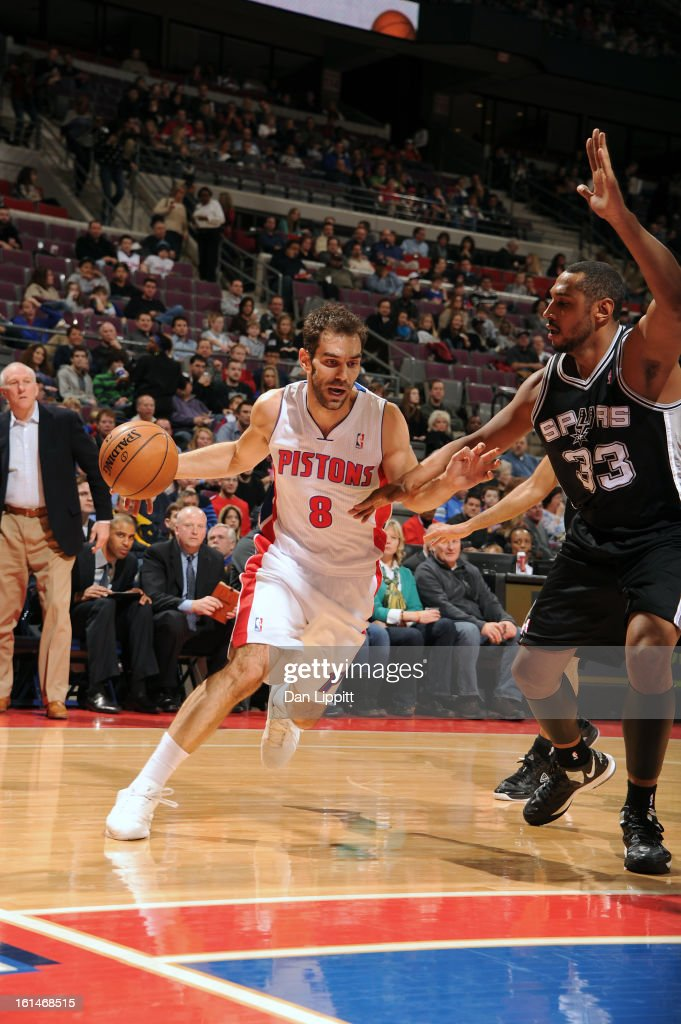 Jose Calderon #8 of the Detroit Pistons drives to the basket against <a gi-track='captionPersonalityLinkClicked' href=/galleries/search?phrase=Boris+Diaw&family=editorial&specificpeople=201505 ng-click='$event.stopPropagation()'>Boris Diaw</a> #33 of the San Antonio Spurs on February 8, 2013 at The Palace of Auburn Hills in Auburn Hills, Michigan.