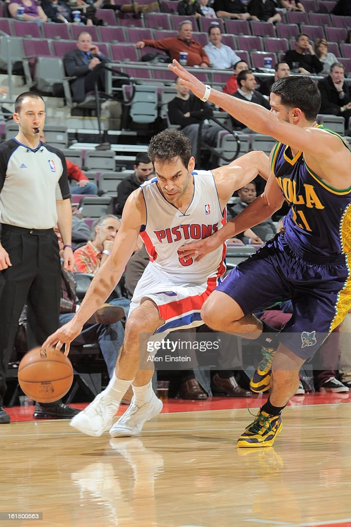Jose Calderon #8 of the Detroit Pistons drives to the basket against Greivis Vasquez #21 of the New Orleans Hornets on February 11, 2013 at The Palace of Auburn Hills in Auburn Hills, Michigan.