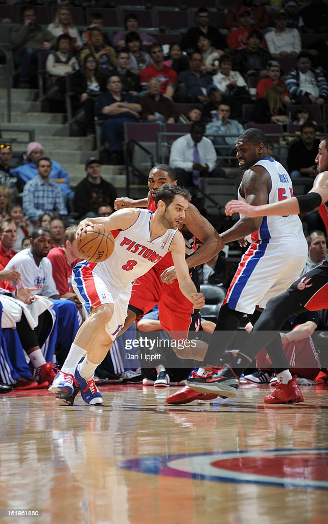 Jose Calderon #8 of the Detroit Pistons drives under pressure during the game between the Detroit Pistons and the Toronto Raptors on March 29, 2013 at The Palace of Auburn Hills in Auburn Hills, Michigan.