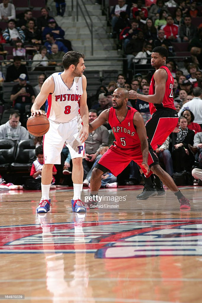 Jose Calderon #8 of the Detroit Pistons protects the ball against John Lucas #5 of the Toronto Raptors during the game between the Detroit Pistons and the Toronto Raptors on March 29, 2013 at The Palace of Auburn Hills in Auburn Hills, Michigan.