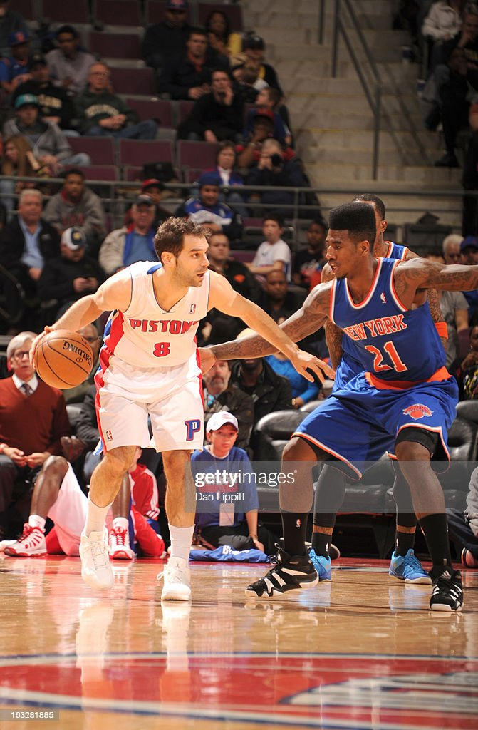 Jose Calderon #8 of the Detroit Pistons protects the ball from Iman Shumpert #21 of the New York Knicks during the game between the Detroit Pistons and the Atlanta Hawks on March 6, 2013 at The Palace of Auburn Hills in Auburn Hills, Michigan.