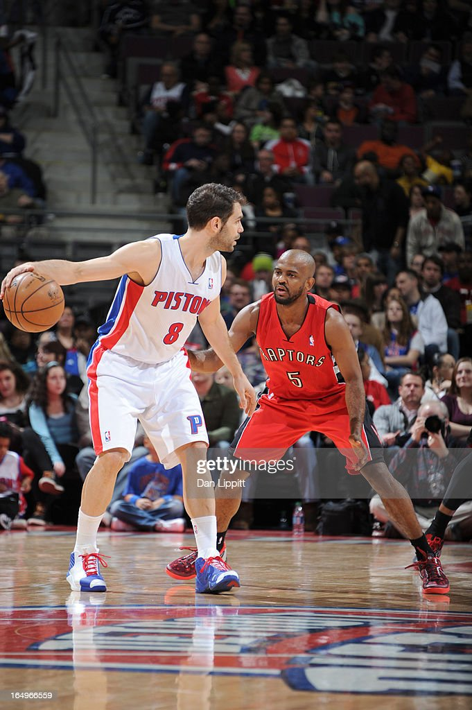 Jose Calderon #8 of the Detroit Pistons protects the ball from John Lucas #5 of the Toronto Raptors during the game between the Detroit Pistons and the Toronto Raptors on March 29, 2013 at The Palace of Auburn Hills in Auburn Hills, Michigan.