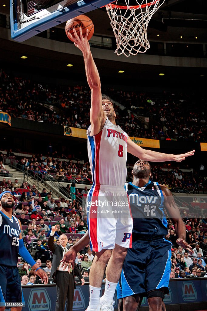 Jose Calderon #8 of the Detroit Pistons shoots a layup against <a gi-track='captionPersonalityLinkClicked' href=/galleries/search?phrase=Elton+Brand&family=editorial&specificpeople=201501 ng-click='$event.stopPropagation()'>Elton Brand</a> #42 of the Dallas Mavericks on March 8, 2013 at The Palace of Auburn Hills in Auburn Hills, Michigan.