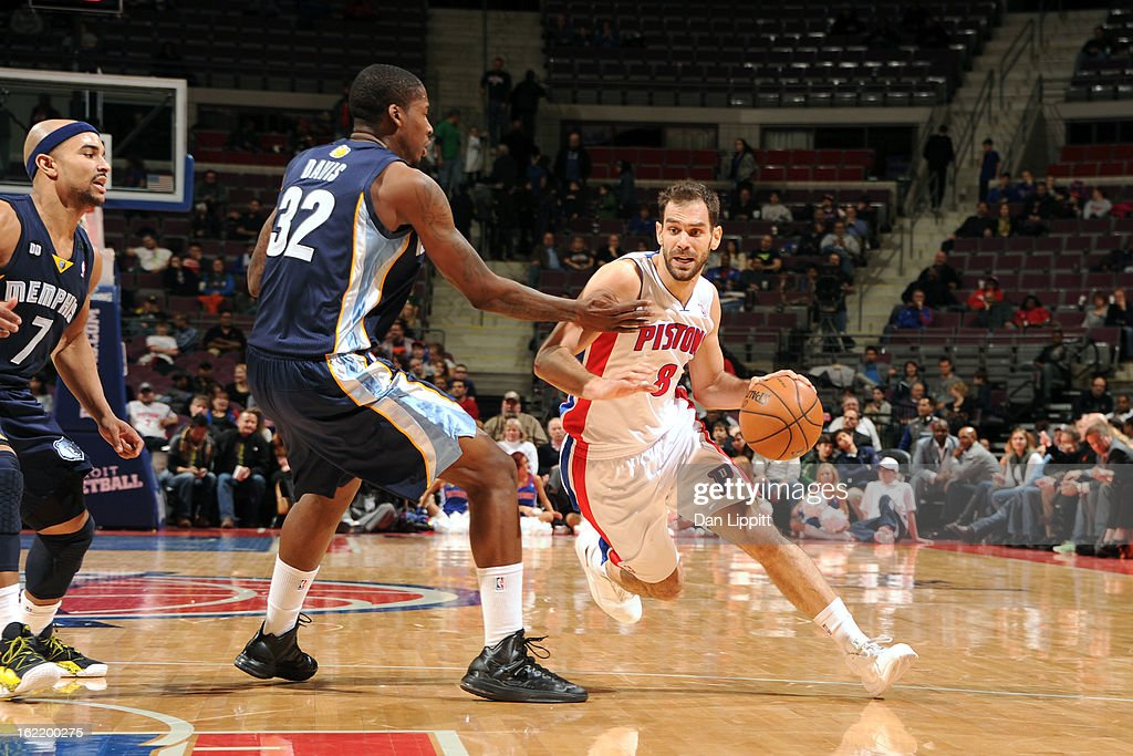 Jose Calderon #8 of the Detroit Pistonsl handles the ball against Ed Davis #32 of the Memphis Grizzlies on February 19, 2013 at The Palace of Auburn Hills in Auburn Hills, Michigan.