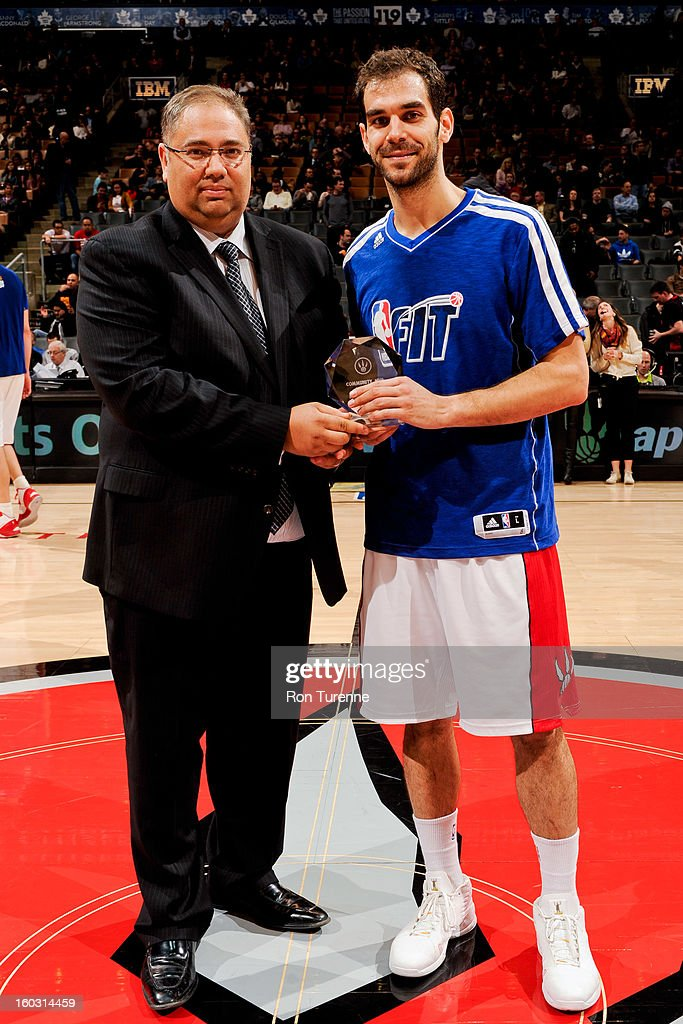 Jose Calderon #8 of the Toronto Raptors accepts a Citizen Eco-Drive Community MVP of the Month award during a game against the Golden State Warriors on January 28, 2013 at the Air Canada Centre in Toronto, Ontario, Canada.
