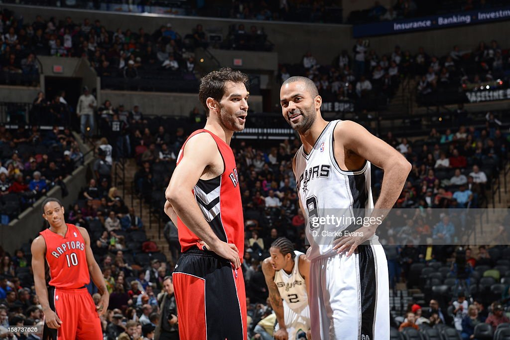 Jose Calderon #8 of the Toronto Raptors and Tony Parker #9 of the San Antonio Spurs share a laugh during the game between the Toronto Raptors and the San Antonio Spurs on December 26, 2012 at the AT&T Center in San Antonio, Texas.