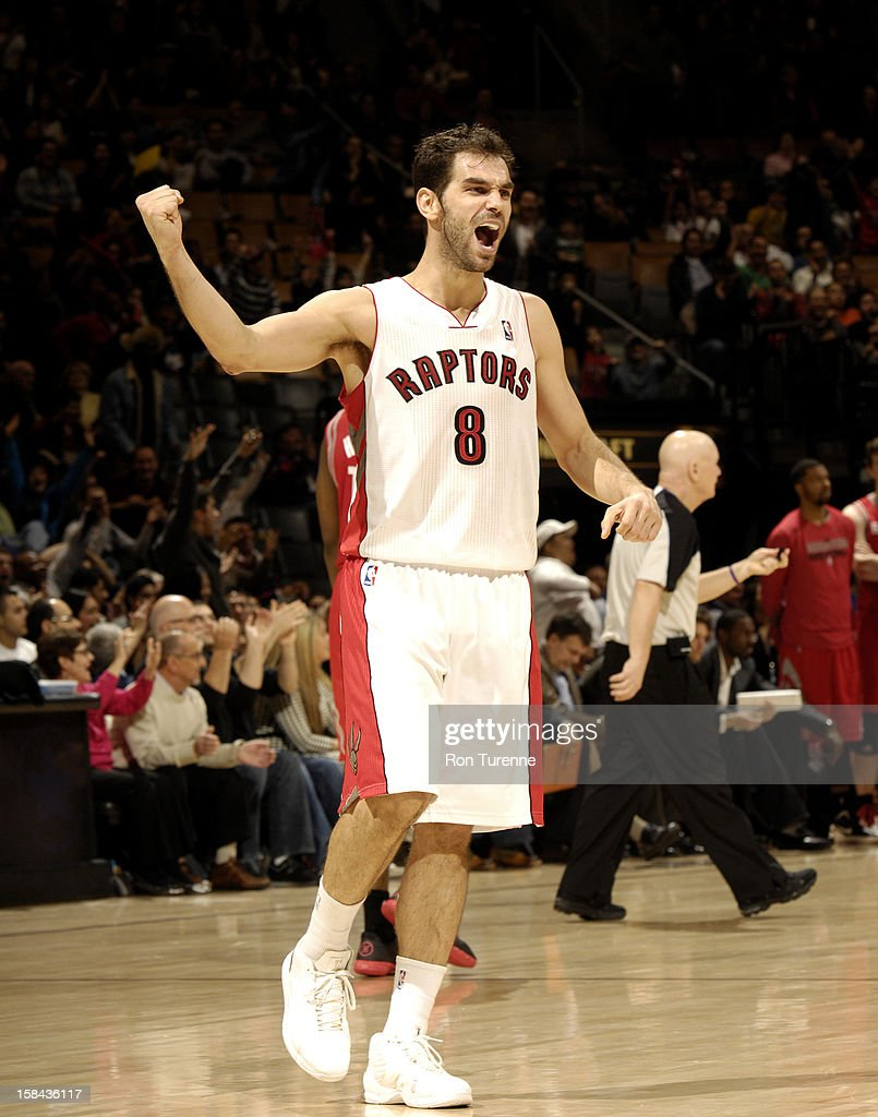 Jose Calderon #8 of the Toronto Raptors celebrates during the game between the Toronto Raptors and the Houston Rockets December 16, 2012 at the Air Canada Centre in Toronto, Ontario, Canada.