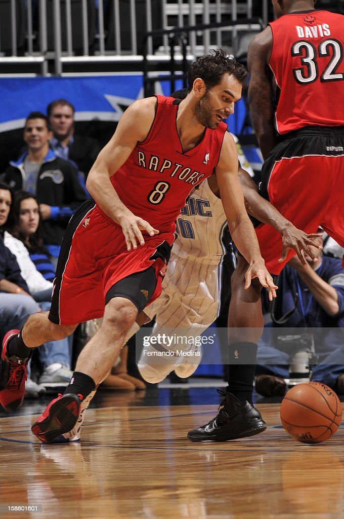 Jose Calderon #8 of the Toronto Raptors dribbles the ball against the Orlando Magic during the game on December 29, 2012 at Amway Center in Orlando, Florida.