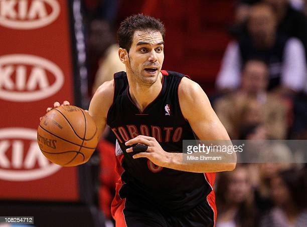 Jose Calderon of the Toronto Raptors dribbles the ball during a game against the Miami Heat at American Airlines Arena on January 22 2011 in Miami...