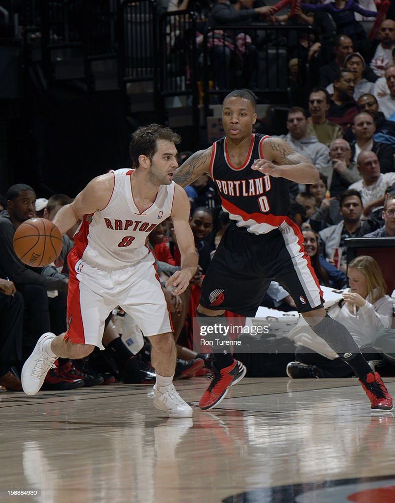 Jose Calderon #8 of the Toronto Raptors dribbles the ball up the floor against Damian Lillard #0 of Portland Trail Blazers during the game on January 2, 2013 at the Air Canada Centre in Toronto, Ontario, Canada.
