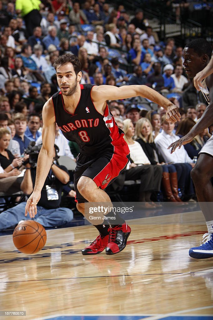 Jose Calderon #8 of the Toronto Raptors dribbles the ball upcourt against the Dallas Mavericks on November 5, 2012 at the American Airlines Center in Dallas, Texas.
